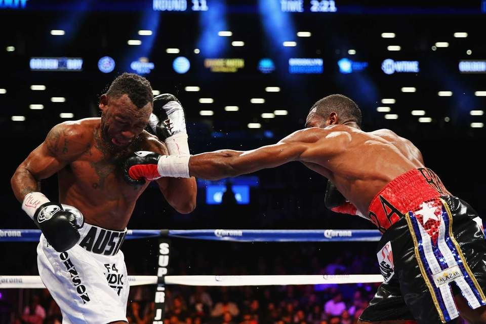 Erislandy Lara punches Austin Trout during their WBA