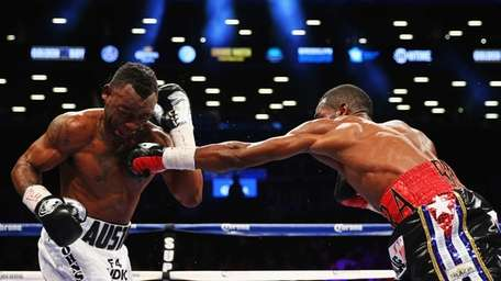 Erislandy Lara punches Austin Trout during their WBA