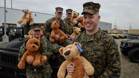 Marine Sgt. Shane Larkin, right, stands with some