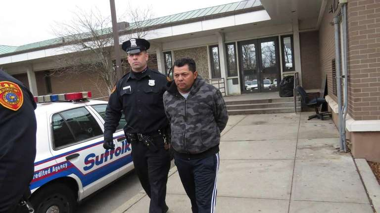 Fredy Pavon, 47, of Brentwood, is escorted from