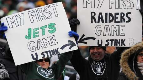 Jets and Raiders fans during the first half