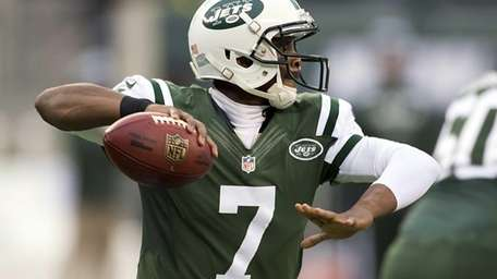 Geno Smith passes the ball during a game