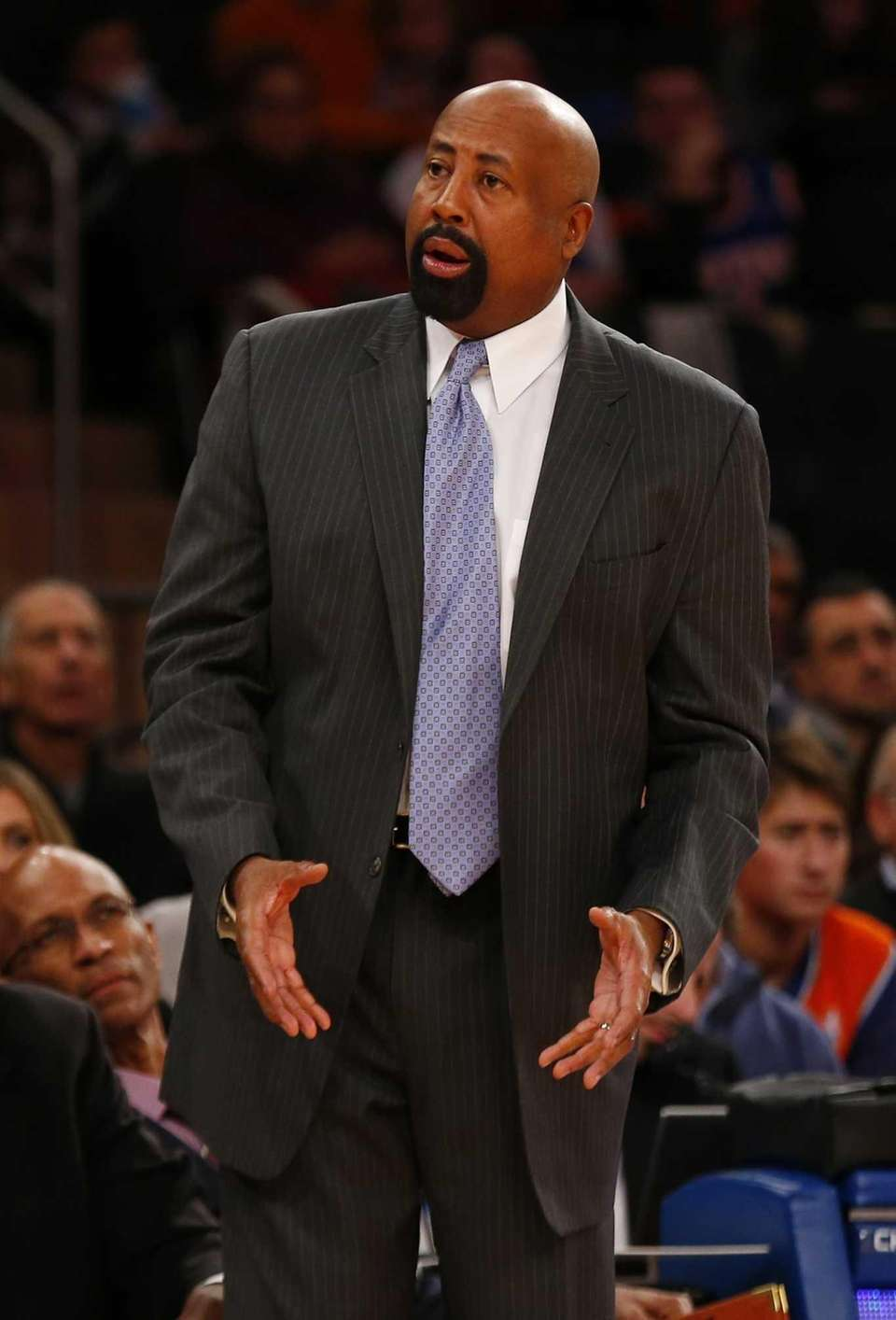 Mike Woodson looks on from the bench during
