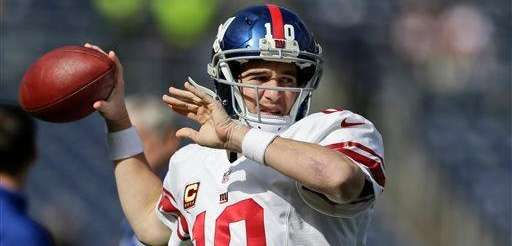 Eli Manning throws during pregame activities before a