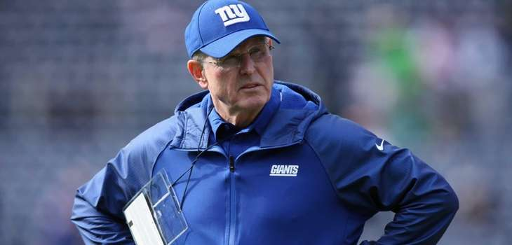 Tom Coughlin looks on before the start of