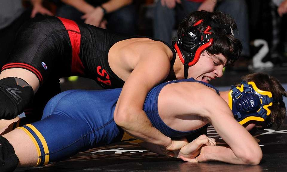 Alexander Vargas of Syosset, top, looks to control