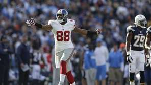 Hakeem Nicks gives the first down signal after