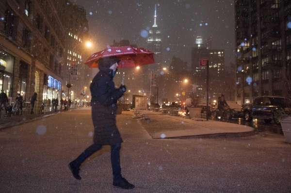 Pedestrians cope with snowy conditions in the Flatiron