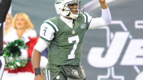 Geno Smith celebrates during the second half of