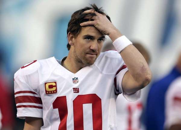 Eli Manning reacts on the sidelines in the