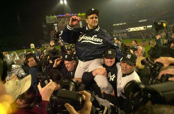Yankees manager Joe Torre is carried off the