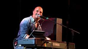 Michael DelGuidice plays a gig at The Emporium