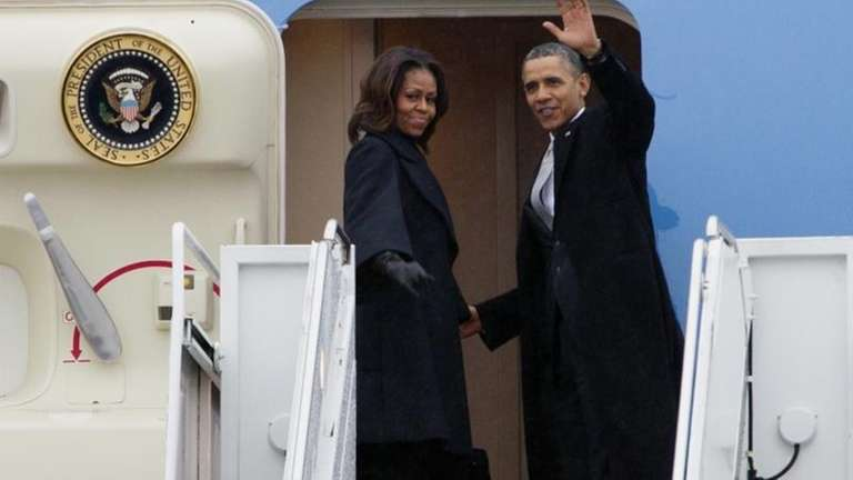 President Barack Obama, accompanied by first lady Michelle