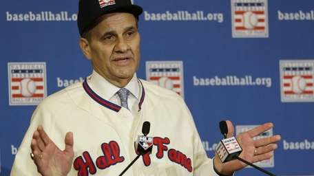 Joe Torre speaks at a news conference after