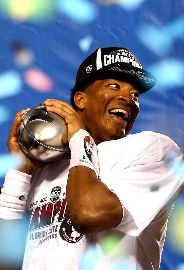 Florida State quarterback Jameis Winston celebrates on stage