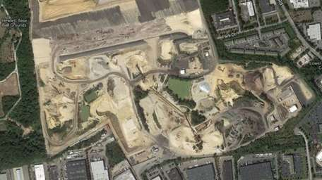 An aerial image shows the industrial dumping site