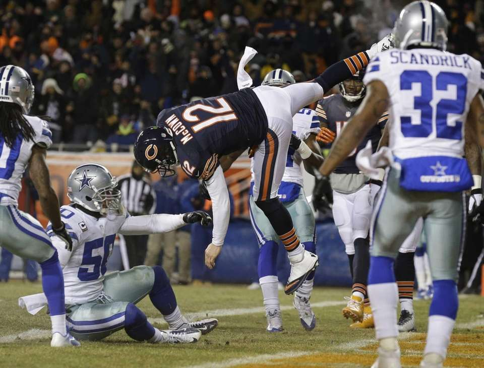 Chicago Bears quarterback Josh McCown (12) gets hit
