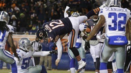 Chicago Bears quarterback Josh McCown (12) gets hit