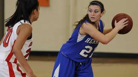 Herricks guard Barbara Nictas protects the ball from