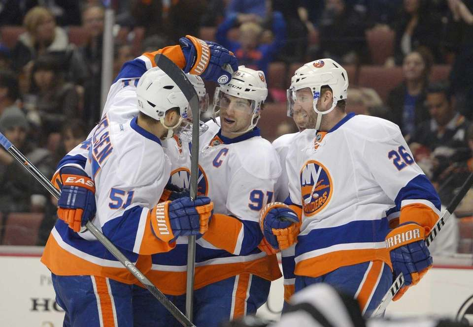 John Tavares, center, is congratulated by center Frans