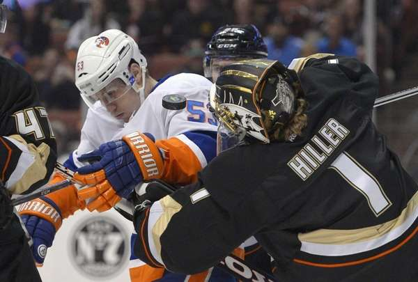 Islanders' Casey Cizikas, left, and Anaheim Ducks goalie