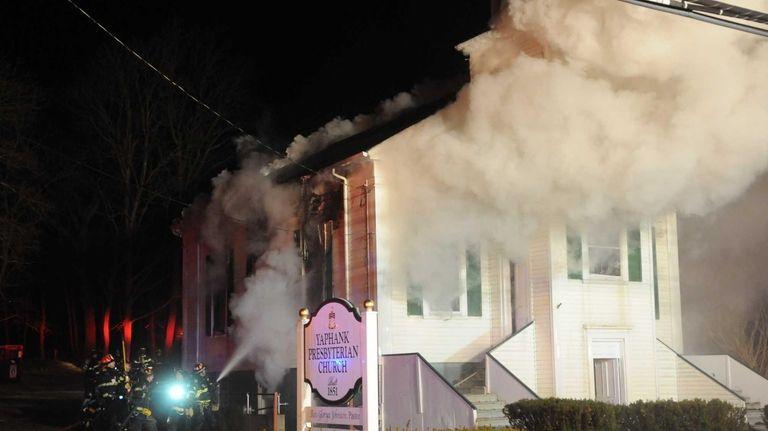 Firefighters battle a blaze at the Yaphank Presbyterian