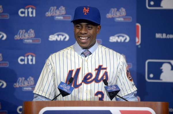 Curtis Granderson answers a question during a news