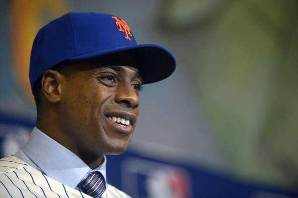 Mets outfielder Curtis Granderson answers a question during