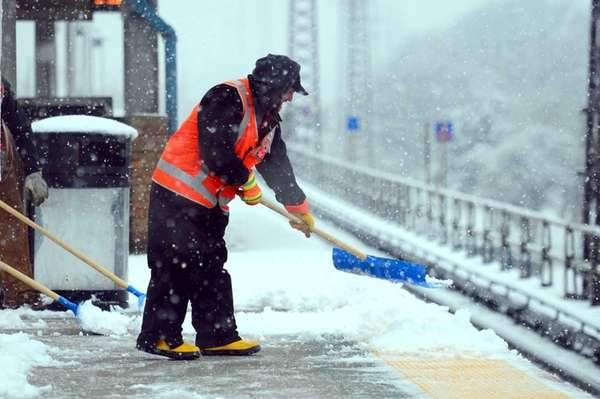 An LIRR worker clears the platform at the