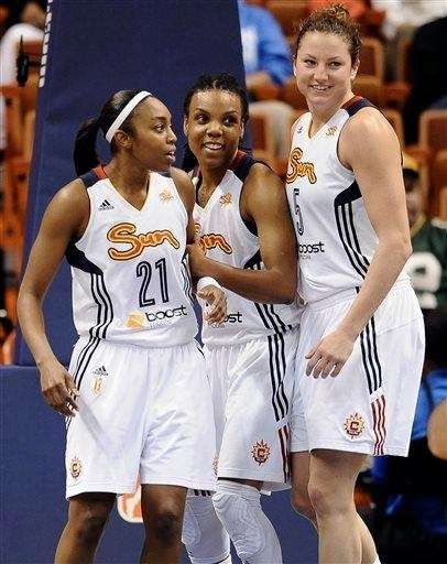The Connecticut Sun's Renee Montgomery, left, Tan White,