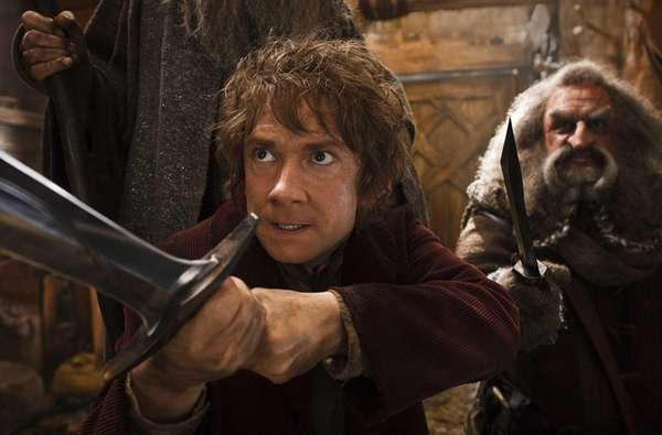Martin Freeman portrays Bilbo, left, and John Callen
