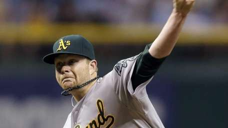 Oakland Athletics starting pitcher Brett Anderson delivers to