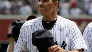 Former Yankees manager Joe Torre reacts during Old