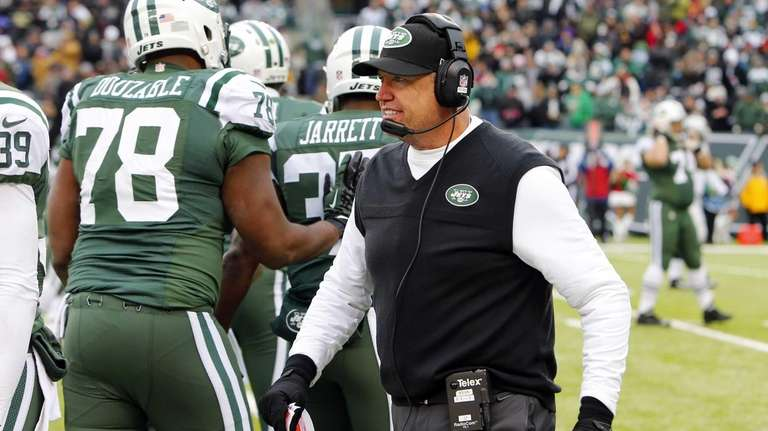 Rex Ryan looks on late in the first