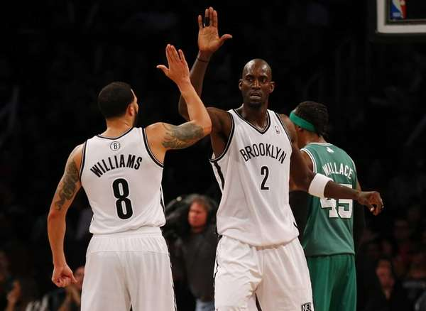Kevin Garnett and Deron Williams of the Nets