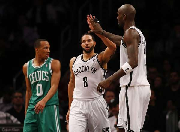 Deron Williams and Kevin Garnett of the Nets