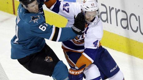 Islanders' Andrew MacDonald collides with San Jose Sharks'