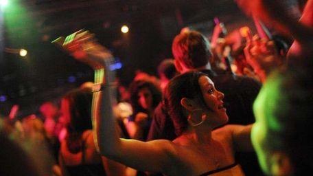 People dance at the Nutty Irishman in Bay