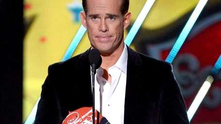 Joe Buck presents an award during the 2013