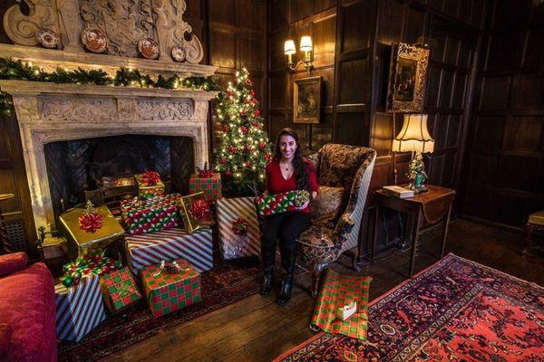 Intern Andrea Crivello wraps presents at Coe Hall