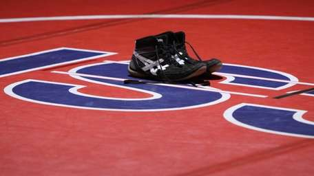 Cody Taddonio's wrestling shoes are placed at the