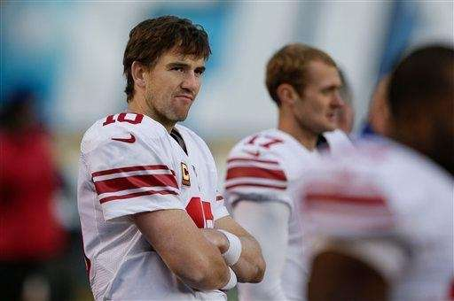 Eli Manning looks on the from the sidelines