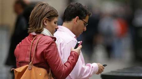 Cellphone users in downtown San Francisco. (June 5,