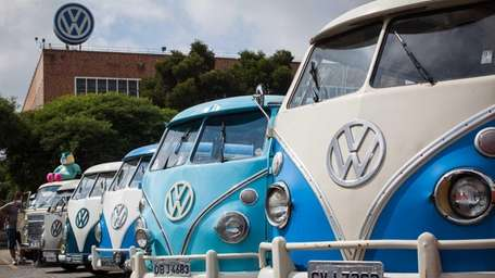 Volkswagen Kombi minibuses are lined up during an