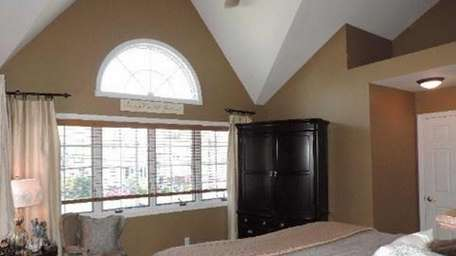 The master bedroom in this Massapequa home, on