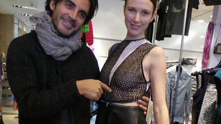Designer Yigal Azrouel with a model, shows off