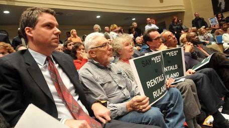 Community members in favor of a development offering