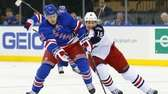 Derek Stepan tries to carry the puck up