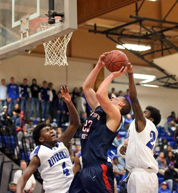 Smithtown West's Tyler Weigl gets fouled by Riverhead's