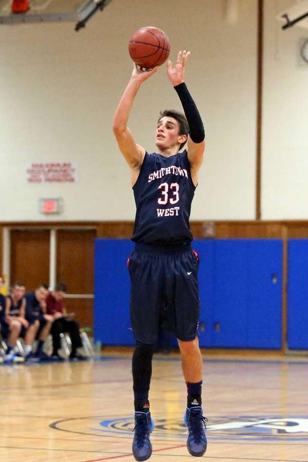 Smithtown West's Nicholas Paquette attempts a three-point shot